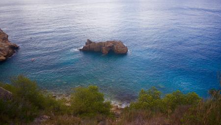 nudist: Cala de Ambolo - Javea - Spain Stock Photo