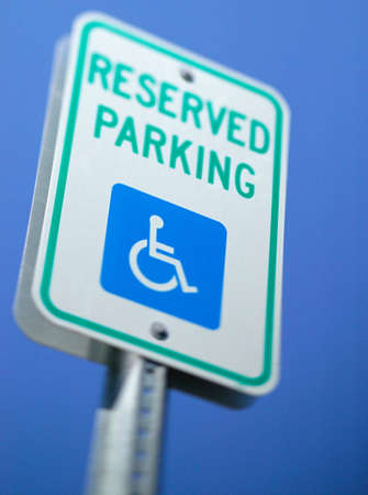 physically: A handicap reserved parking sign for those who are physically disabled.