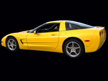 A yellow performance car on a black background. Imagens