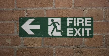 Fire exit sign on bricks photo