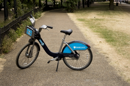 boris: London, UK - July 20, 2013  A single Barclays Bike in a park, These bikes are also known as  Boris Bikes