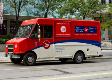 postes: TORONTO, CANADA - OCTOBER 18, 2013  A Canadian Post van on a road in Toronto  Canada Post Corporation is Canada s primary postal operator in the country Editorial