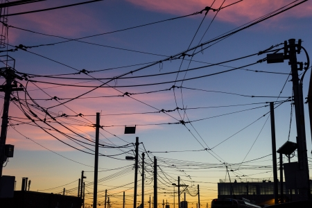 Street car cables at sunset photo