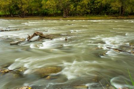 rushing water: Rushing water on a river