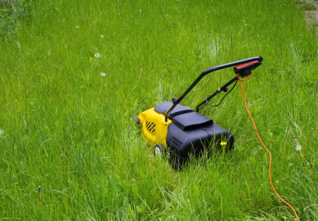 Lawn mower in long grass photo
