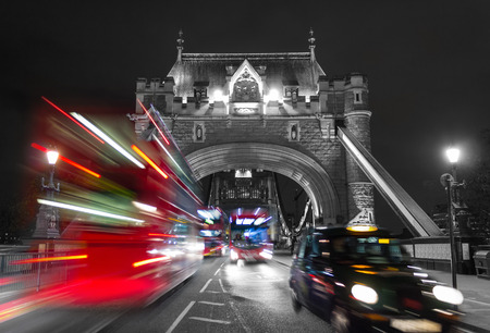 A view of the entrance to Tower Bridge with typical London traffic with a color mix effect