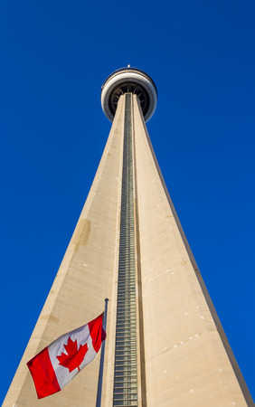 TORONTO, CANADA - 8TH OCTOBER 2013  View of the CN Tower from ground level with the Canadian Flag at the bottom of the tower