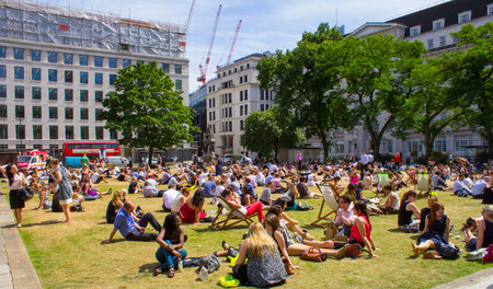 LONDON, UK - 15th JULY 2013  Large amounts of people relaxing at Finsbury Square during the lunchtime hours in the summer