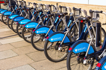 boris: LONDON, UK - 1ST MARCH 2014  A row of Barclays Boris Bikes parked in their docking stations in Central London Editorial