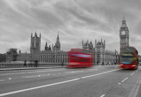 A colormix of Westminster showing bright red buses on a black and white image of Westminster  photo