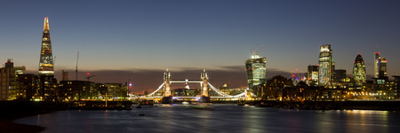 Panoramic of the City of London with Tower Bridge, The Shard, Walkie Talkie, Gherkin and other skyscrapers photo