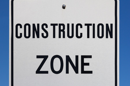 A closeup to a Construction Sign during the day photo