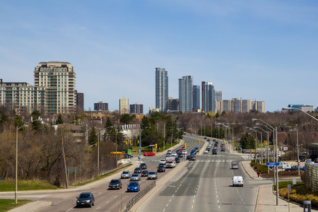sheppard: TORONTO, CANADA - 28TH APRIL 2014  A high view showing traffic along Sheppard Avenue and Modern Condos in the background in uptown Toronto Editorial