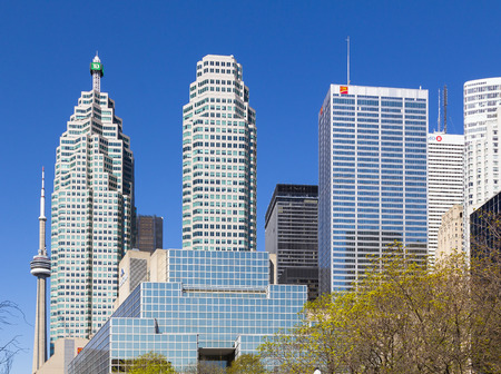 td: TORONTO, CANADA- 11TH MAY 2014  The TD, CIBC, BMO and other Skyscrapers during the day with the CN Tower in the background