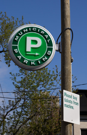 TORONTO, CANADA- 18TH MAY 2014  Sign for Municipal Parking in Toronto during the day