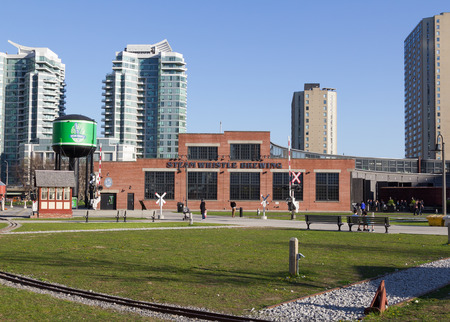 TORONTO, CANADA - 22ND MAY 2014  The outside of the Steam Whistle Brewing building during the day and people can be seen outside the building