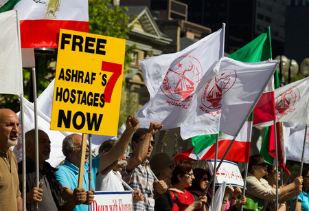 TORONTO, CANADA - 25TH MAY 2014  People at a demonstration in Toronto, protesting for the release of 7 hostages from camp Ashraf