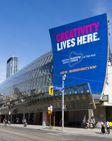 TORONTO, CANADA - MAY 31, 2014: The outside of the Art Gallery of Ontario in Toronto. People can be seen outside the building
