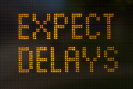 A sign informing motorists to expect delays photo