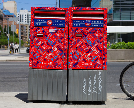 TORONTO, CANADA - JUNE 1ST, 2014: Closeup to two Canada Post Boxes at the side of a road in downtown Toronto