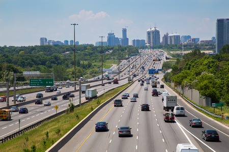 developed: TORONTO, CANADA - JUNE 16, 2014: High view of part of Highway 401 running through Toronto during the day with lots of traffic.