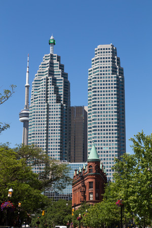 td: TORONTO, CANADA - 22 JUNE 2014: A view of the TD Towers, The CN Tower and part of the Flatiron from the East Editorial