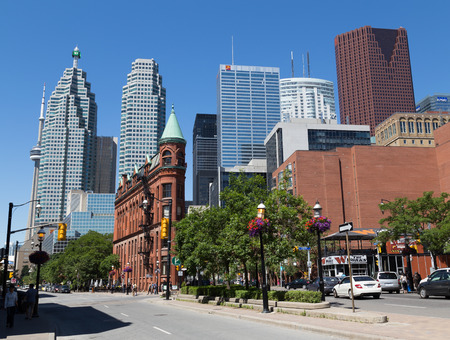 distant work: TORONTO, CANADA - 22 JUNE 2014: A view down Front Street East towards Downtown Toronto