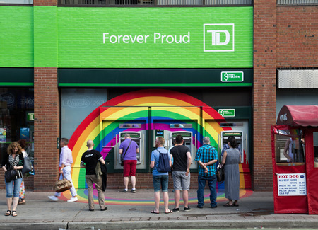 td: TORONTO, CANADA - 26 JUNE 2014: Rainbow decoration around the ATMs for a TD Bank branch in celebration of the World Pride Festival Editorial