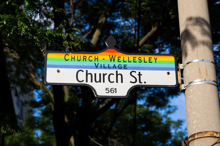 TORONTO, CANADA - 26 JUNE 2014: Sign for Church Wellesley Village in downtown Toronto