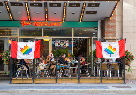 wellesley: TORONTO, CANADA - 26 JUNE 2014: Signs outside Restaurants to show support for World Pride in Toronto