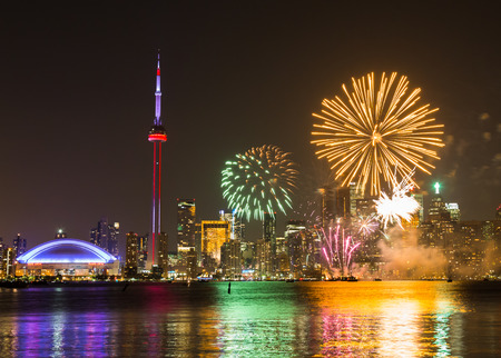 canada day: TORONTO, CANADA - 30TH JUNE 2014: Fireworks in Toronto for Canada Day showing the City and local landmarks Editorial