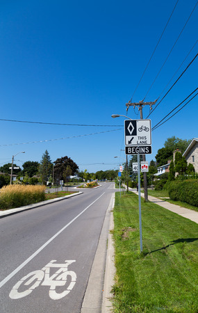 bicycle lane: TORONTO, CANADA - 19 AUGUST 2014: A cycle Lane in Toronto showing a sign and road markings