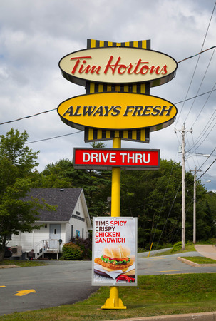 HALIFAX, CANADA - 21ST AUGUST 2014: A sign for a Tim Hortons Restaurant along a road during the day