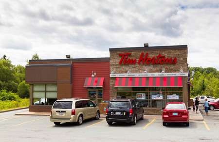 HALIFAX, CANADA - 21ST AUGUST 2014: The outside of a Tim Hortons Restaurant during the day. People and traffic can be seen outside the restaurant.