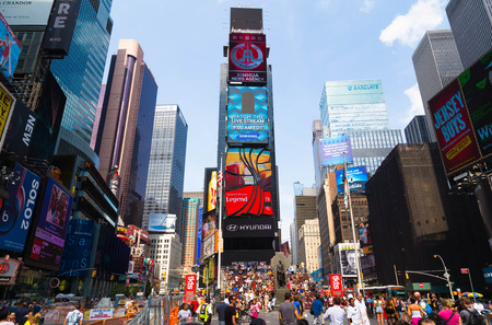 during the day: NEW YORK CITY, USA - 31ST AUGUST 2014: Time Square during the day showing large amounts of people and led billboards