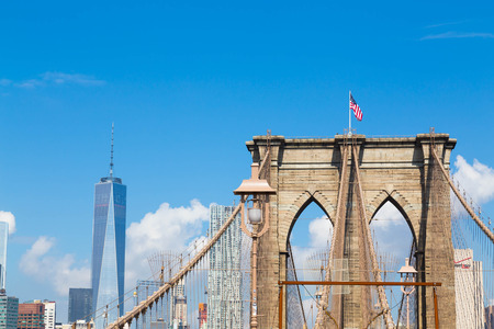 world trade center: NEW YORK CITY, USA - 1ST SEPTEMBER 2014: A view of the arches of Brooklyn Bridge in NYC with One World Trade Center in the background