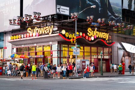 42nd: NEW YORK CITY, USA - 30TH AUGUST 2014: A subway stop along 42nd Street near the Theatre Disrict. Showing large amounts of people outside the entrance