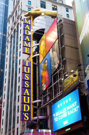 42nd: NEW YORK CITY, USA - 30TH AUGUST 2014: A sign for Madame Tussauds down 42nd Street in New York City during the day