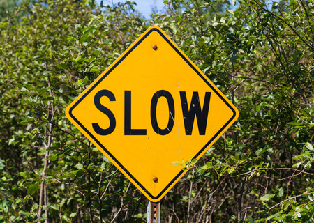 slowly: A sign informing that drivers should drive slowly
