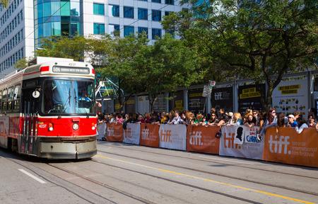 september 9th: TORONTO, CANADA - 9TH SEPTEMBER 2014: Spectators on on the street for the Tiff festival in Toronto Editorial