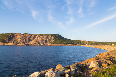 mined: The side of Cape Porcupine and part of the Canso Causeway linking Cape Breton to the Nova Scotia peninsula Stock Photo