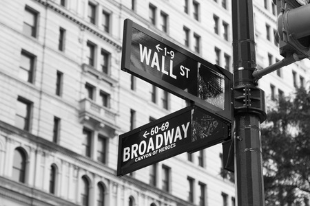 street signs: Wall Street and Broadway Street Signs in black and white