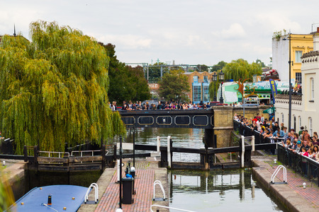 amounts: LONDON, UK - 27TH SEPTEMBER 2014: Part of Camden Locks during the day showing large amounts of people either side