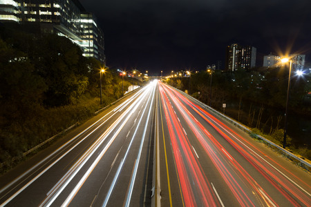 Light trails on a highway at night photo