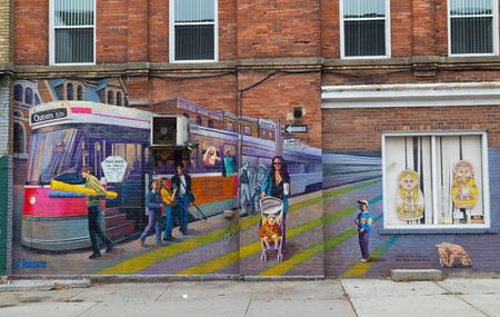 TORONTO, CANADA - 7TH OCTOBER 2014: Wall art along Queen Street West in Toronto