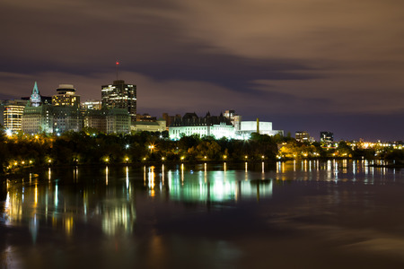 Part of the Ottawa Skyline at Night showing reflections in Ottawa River photo