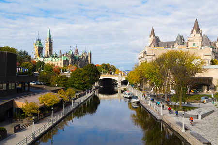 rideau canal: OTTAWA, CANADA -  11TH OCTOBER 2014: A view up the rideau Canal towards the Ottawa Parliament. Cyclists can be seen along the Canal