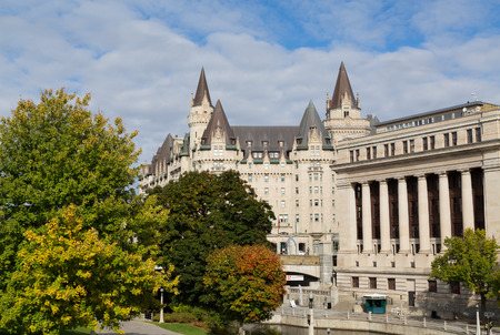 rideau canal: OTTAWA, CANADA -  11TH OCTOBER 2014: Various buildings in Ottawa during the day near the Rideau Canal Editorial