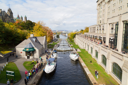rideau canal: OTTAWA, CANADA -  12TH OCTOBER 2014: Ottawa Locks along the Rideau Canal during the day. Boats and people can be seen