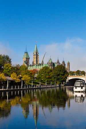 rideau canal: OTTAWA, CANADA - 12TH OCTOBER 2014: Part of the Ottawa Parliament Buildings from the Rideau Canal Editorial